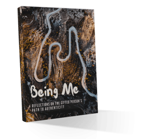 Cover art for the Being Me: Reflections on the Gifted Person's Path to Authenticity community writing and creative expression project organised by InterGifted, featuring an aerial view of a road winding deeply through a brown landscape dotted with yellow-green trees.